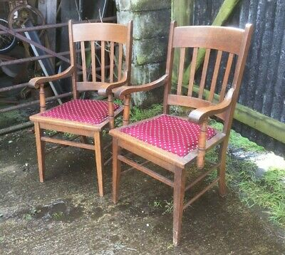 Pair Of Arts And Crafts Oak Arm Chairs
