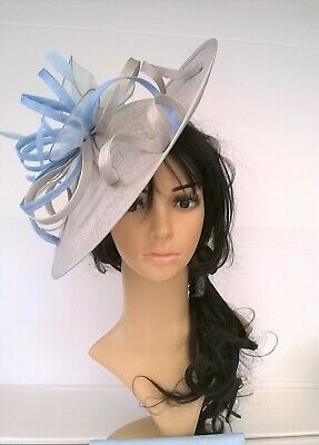 Silver Grey hatinator with Blue sinamay & feather shaped disc Wedding.races.new