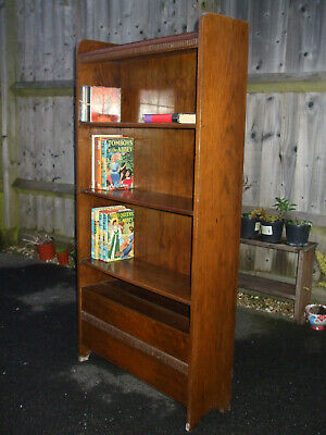 Vintage oak bookcase with paper rack, good quality, 1930s era, golden oak colour