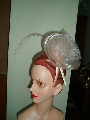 Fascinator/hat blush pink on headband worn once only.