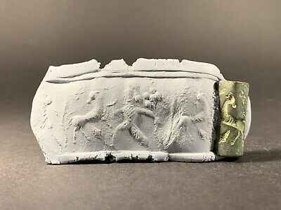 Ancient Babylonian Bronze Cylindrical Seal Depicting Hunter Scene Circa 1800Bc