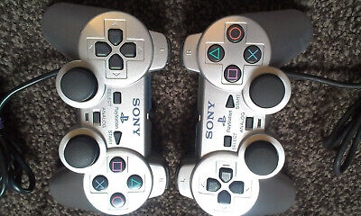 2 x OFFICIAL SONY PS2 SILVER WIRED DUAL SHOCK II CONTROLLERS