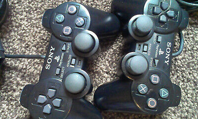 2 x OFFICIAL SONY PS2 BLACK WIRED DUAL SHOCK II CONTROLLERS