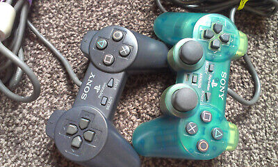 2x PS1 SONY CONTROLLERS 1xBLACK PS1 (SCPH-1080) 1x TRANSPARENT GREEN (SCPH-1200)