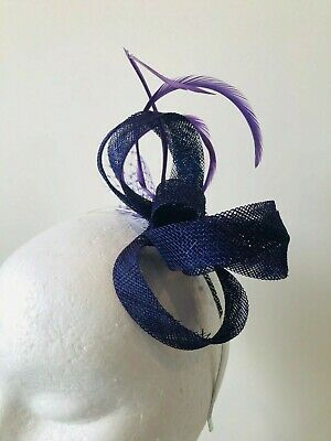 New stunning purple loop fascinator with feathers and netting!
