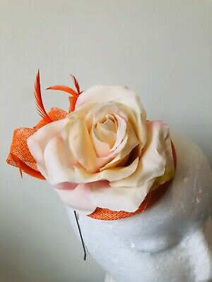 NEW orange round fascinator with loops, feathers and flower on a headband!