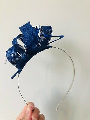 New stunning navy loop fascinator with feathers on a metal headband!