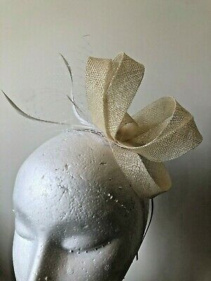 Cream loop fascinator with netting and feathers on a metal headband!