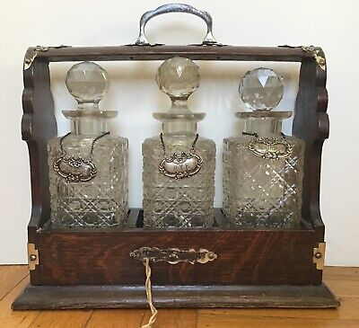 Antique English Oak Tantalus With Sterling Labels