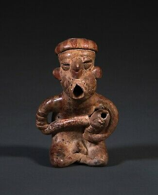 A Superb Pre-Columbian Nayarit Musician Playing A Gourd, Circa 100 Bc-Ad 250