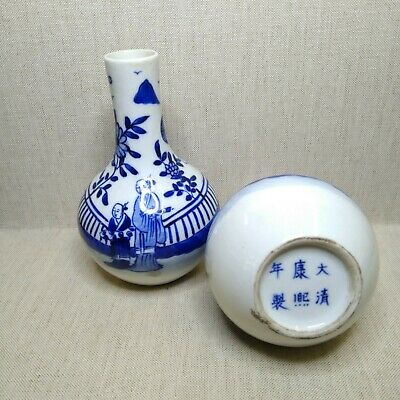 Vintage A pair of Chinese porcelain blue and white vases. There stamped.