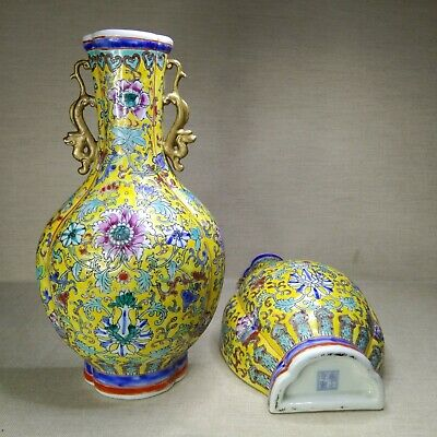 A pair of  Chinese porcelain wall vases. 20th century. There stamped.