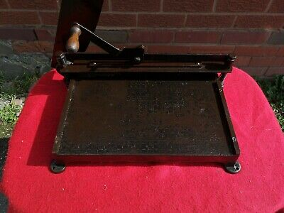 Vintage metal industrial style guillotine / paper cutter.
