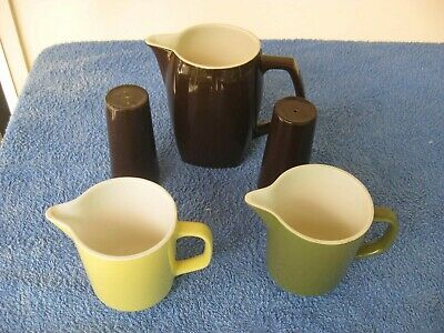 3 milk jugs 2 small, yellow and green 1 larger brown