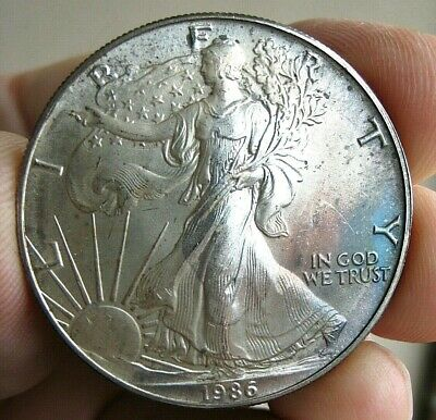Nice 1986 AMERICAN SILVER EAGLE ~ 1 Troy Ounce Fine Silver ~ Toning