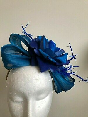 Blue silk abaca loop fascinator with flower and feathers on a headband!
