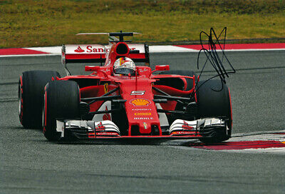 Sebastian Vettel Ferrari 2017 F1 autograph, In-Person signed 8X12 inches photo