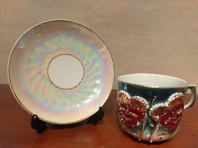 Antique Germany EMBOSSED FLOWERS Iridescent Porcelain CUP SAUCER Gold Gilded Set