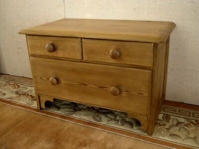 Three drawer small old pine chest with panelled sides