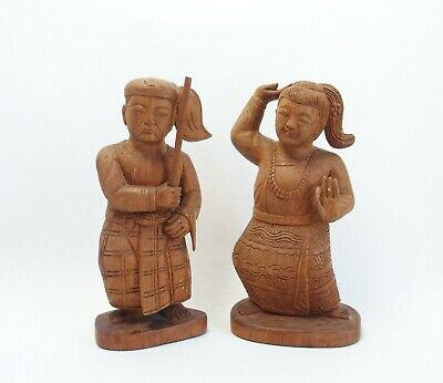 Two vintage Thai carved wooden figures