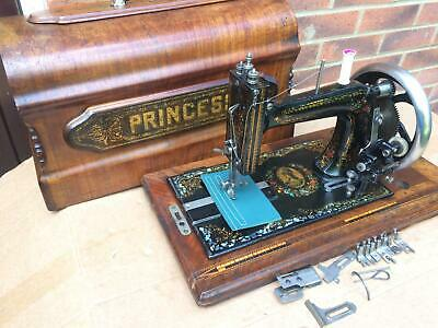 Beautiful Princess-Stoewer Antique Sewing machine with accessories.