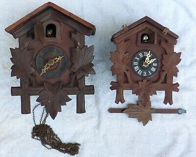 Two Vintage Cuckoo Clocks .  (Spares Or Repairs )  +Chain . Weight .Pendulum .