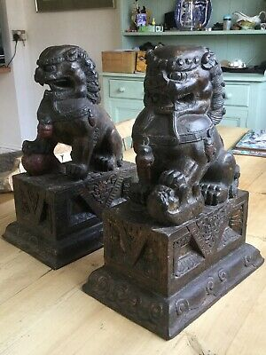 pair of 19 century chinese carved and paintad wood buddhistic lions