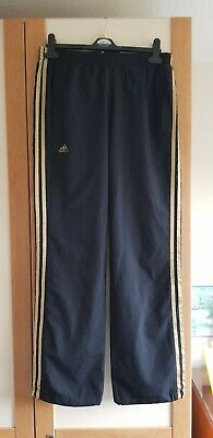 GIRLS -- BOYS BLACK & GOLD ADIDAS CLIMA PROOF TRACKSUIT BOTTOMS  / 13-14 years