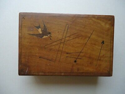 rare puzzle box  with  inlaid  bird  design  on  the lid