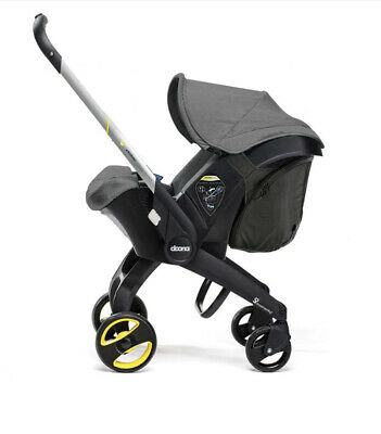 Grey Doona Infant Car Seat Stroller-Storm With rain Cover
