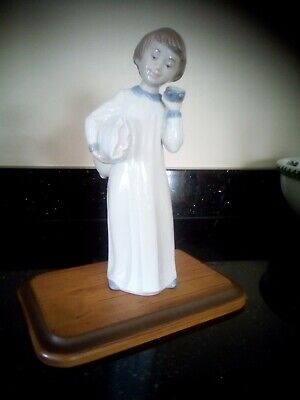 Lladro/Nao Young Boy ready for bed with His pillow and alarm clock