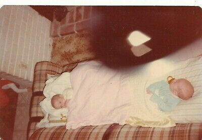 vintage color photo abstract scary creepy twin babies shadow with tear drops