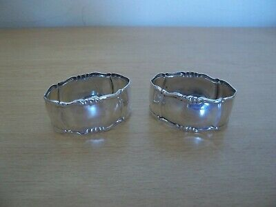 A pair of vintage silver plated 'Art Nouveau' style napkin rings