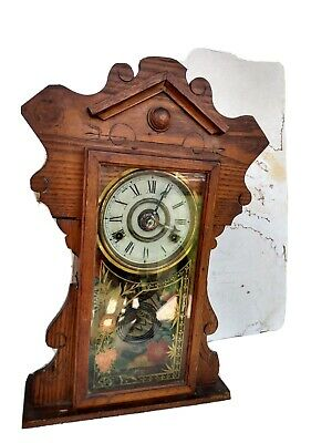 Unbranded Oak Kitchen Clock with Winding Key.  Patented Feb. 11, 1879.