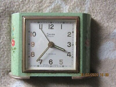 Vintage Swiss made Swiza Coquet clock in good working order with Enamel case