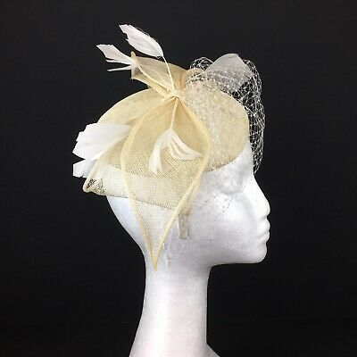 Ladies Natural Coloured Fascinator with White Off White Feathers