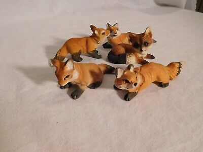Fox family 5 figurines carved wood. Adorable fox family