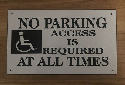 Disabled parking required outside the front of this house sign 3046 Disability