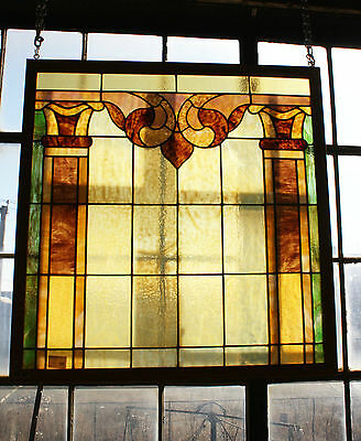 Traditional Caramel Stained Glass Window with Foliate Accent