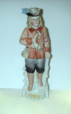 Vintage statue in porcelain showing man with horn - signed and numbered