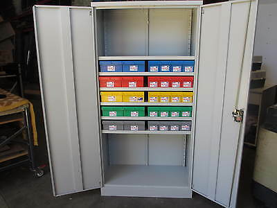 Two Door Cupboard with Australian made Fischer Plastic Spare Parts Trays