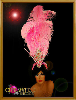 Showgirl/'s green turbaned towering fruit headdress with sunny ostrich feathers