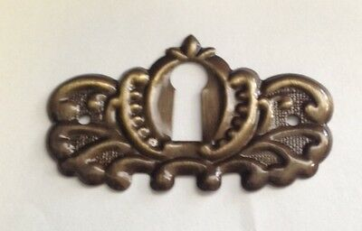 "Stamped Antique Brass Keyhole Cover. 1-7/8"" x 1-1/8"", E-22AB"