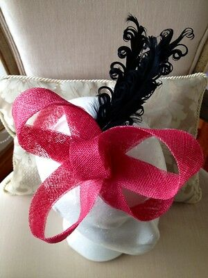 Cute pink bow fascinator with black feathers