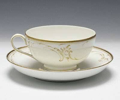KPM Porcelain Cup and Saucer c19th Century. Raised gold gilt scrolls.