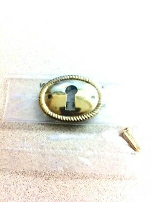 "B-0249 Stamped Brass Keyhole Escutcheon  1"" Diameter"