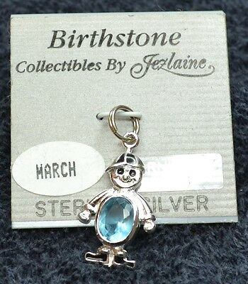 Sterling Silver Scrap/Not ~1 grams March Birthstone Boy and Cap Charm on Backing