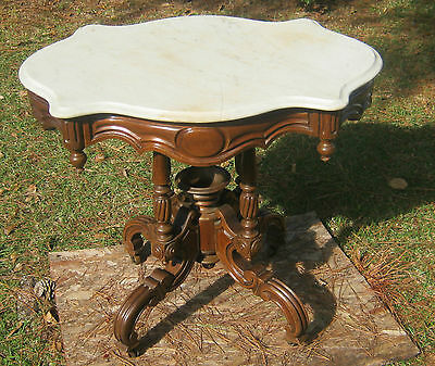 A Victorian table/ Walnut base / marble top/ nice looking