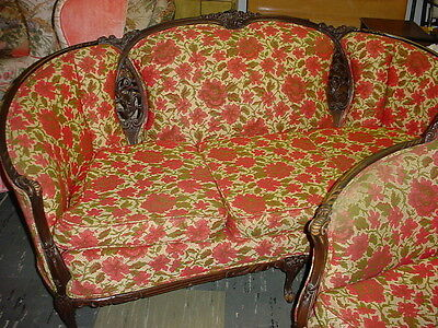 Antique Carved Wood and red floral parlor sofa and matching round-back chair