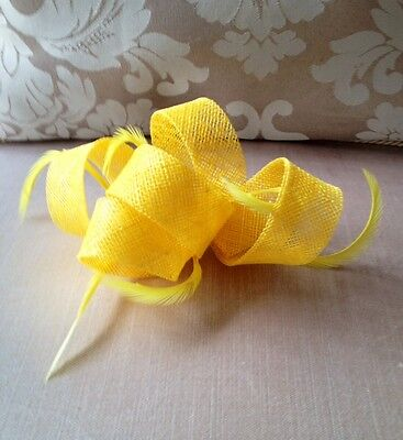Pretty yellow fascinator with feathers!